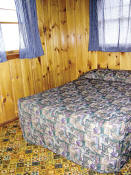 The second bedroom in Cabin #17 has a double bed.