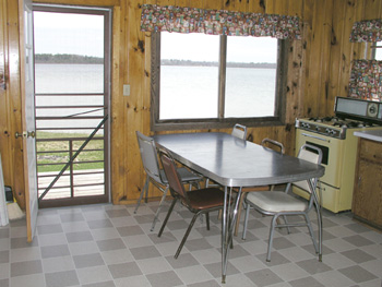 If Cabin #17 were any closer to the lake, you'd be wading in the livingroom.